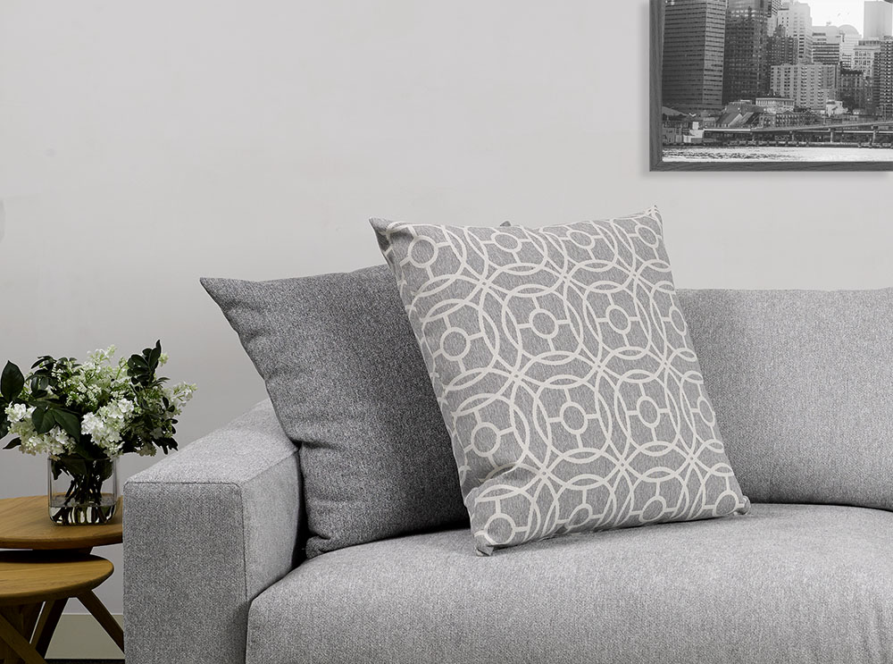 Sofa: Frontier Silver. Scatter: Hooper Pewter.