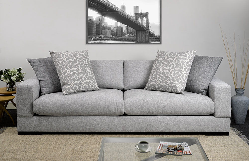 Sofa: Frontier Silver. Scatters: Frontier Pewter, Hooper Pewter.
