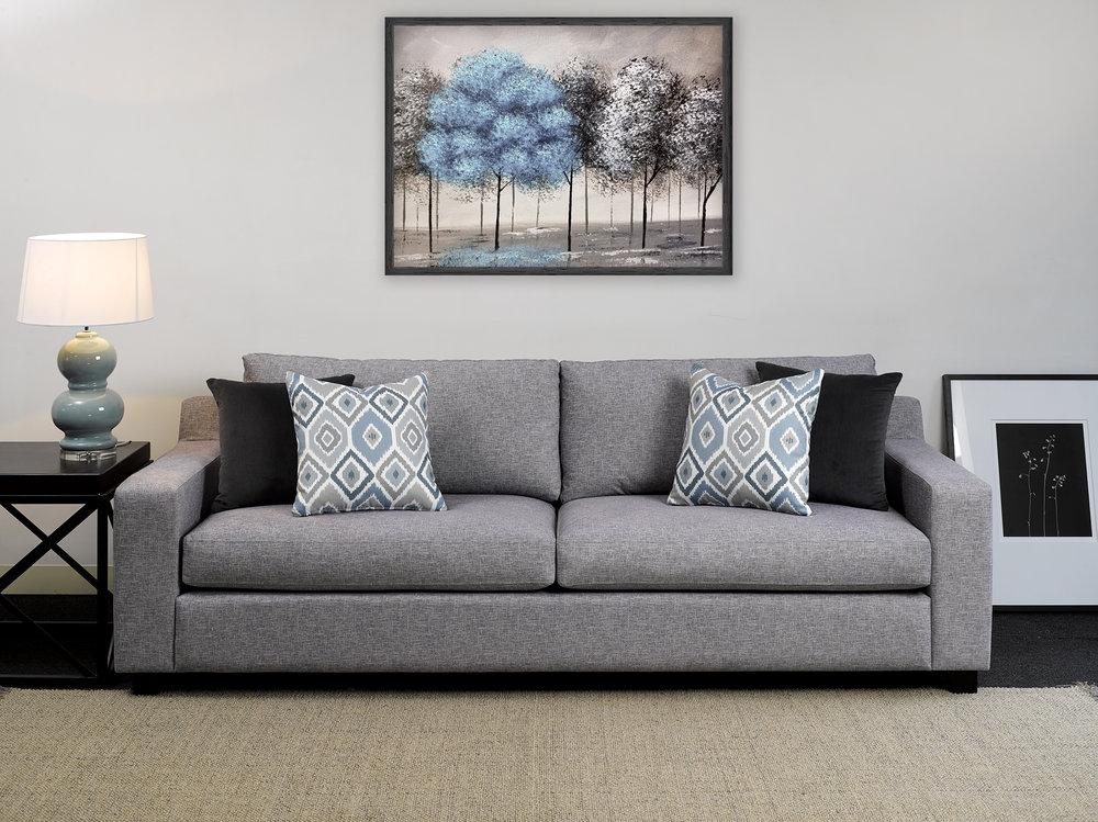 Sofa: Fairmont Silver. Scatters (left to right): Panache Shale, Mokat Sky.