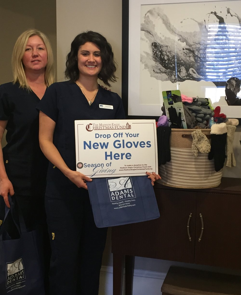 Among the many merchants who served as gift drop-off sites for donations to this year's Madison Eagle Christmas Fund was Adams Dental at 1 Kings Road in Madison.  Collecting new gloves for the Christmas Fund are Business Manager Jennifer Melton, left, and Registered Dental Assistant Danielle Wheelock.