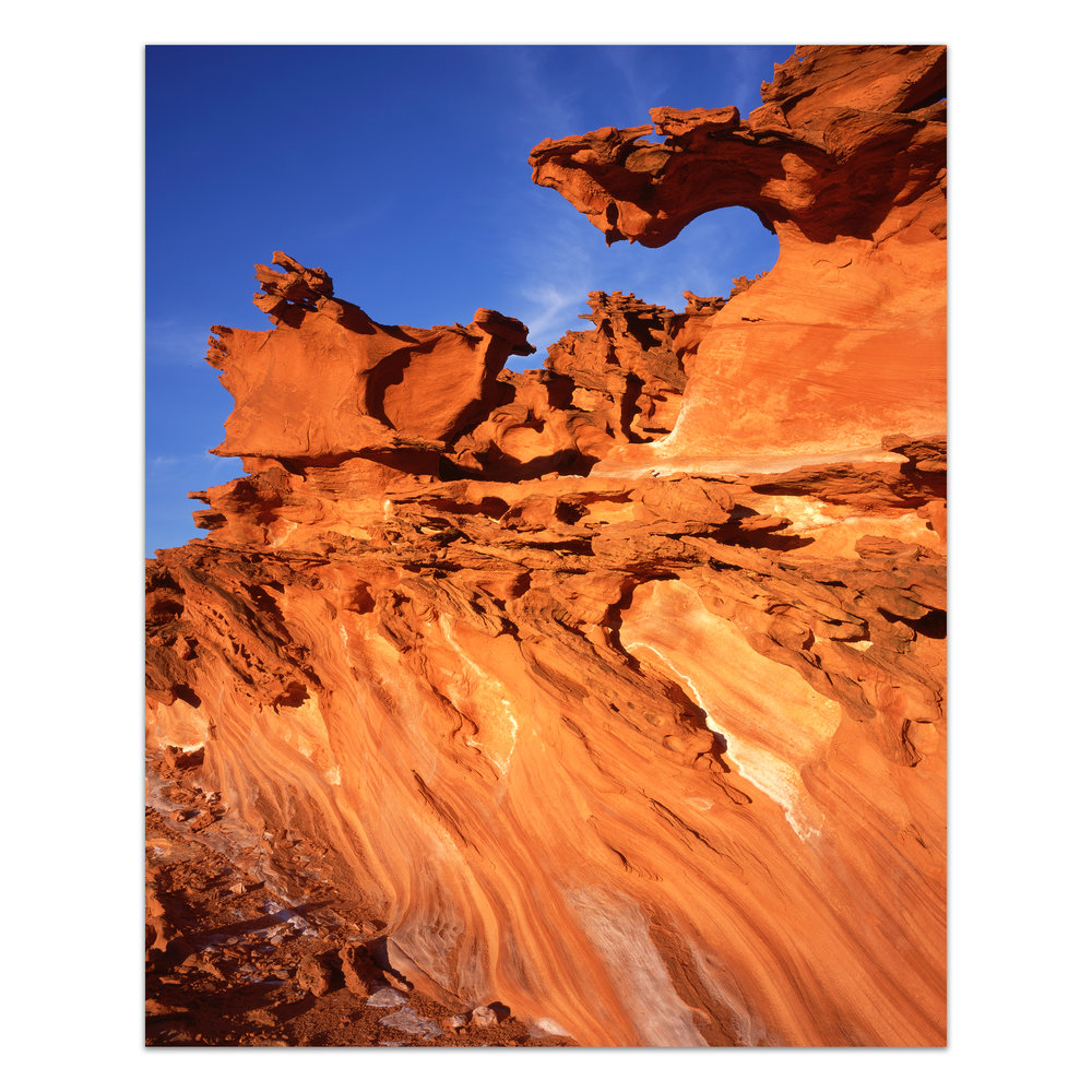 Fire and Ice     Gold Butte Wilderness, Nevada    Edition of 11    In a remote corner of the Mojave roughly 75 miles outside of Las Vegas, the last rays of direct light illuminate brilliant sandstone against an icy blue desert sky.    30x40, 40x50, 48x60