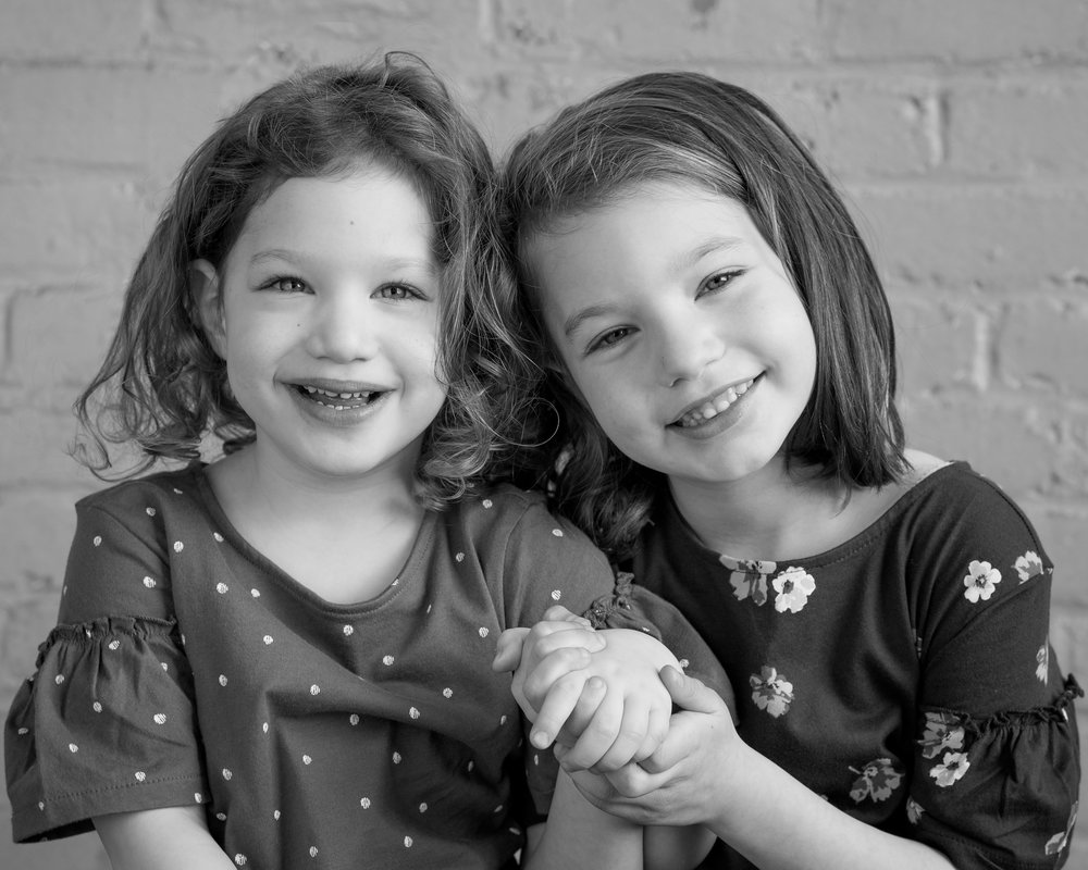 I am so happy with the portrait that Danielle Tait photographed of my grand daughters. They will only be five and three once, but there they are holding hands, in black and white. - Peggy Fiddler