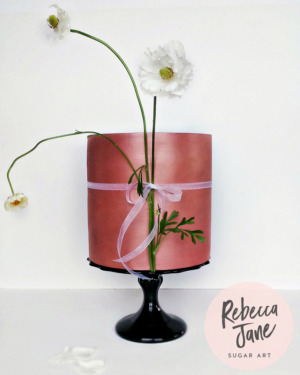 Rebecca Jane Sugar Art - Rose gold metallic cake with long stem ranunculus flowers