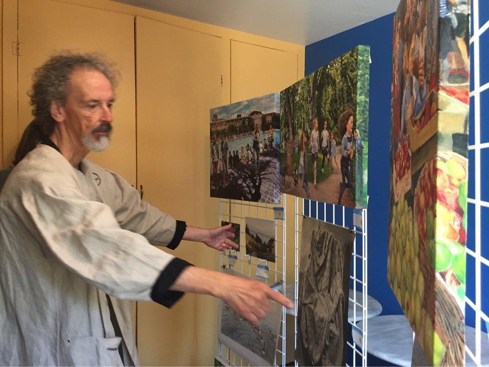Artist explaining work