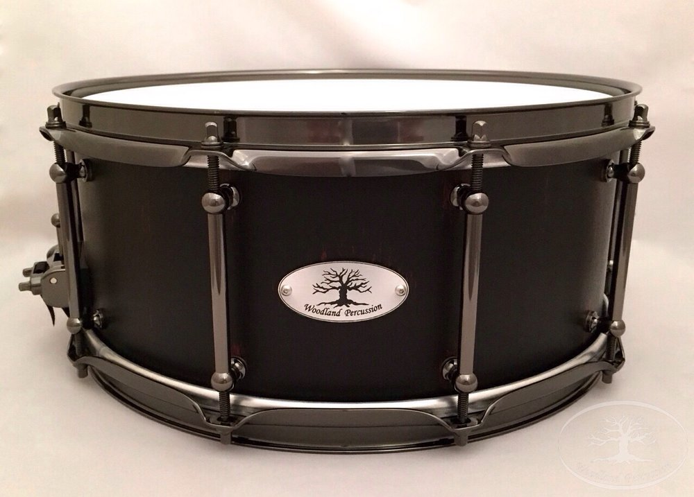 """The Black lodge""   Custom snare designed for jason rubal of seventh wave studio  14x6x3/4 Birch  custom  Red Room  finish with bBack Chrome hardware"