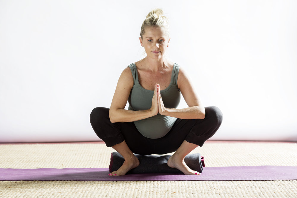 Pregnant squat heals supported.jpg
