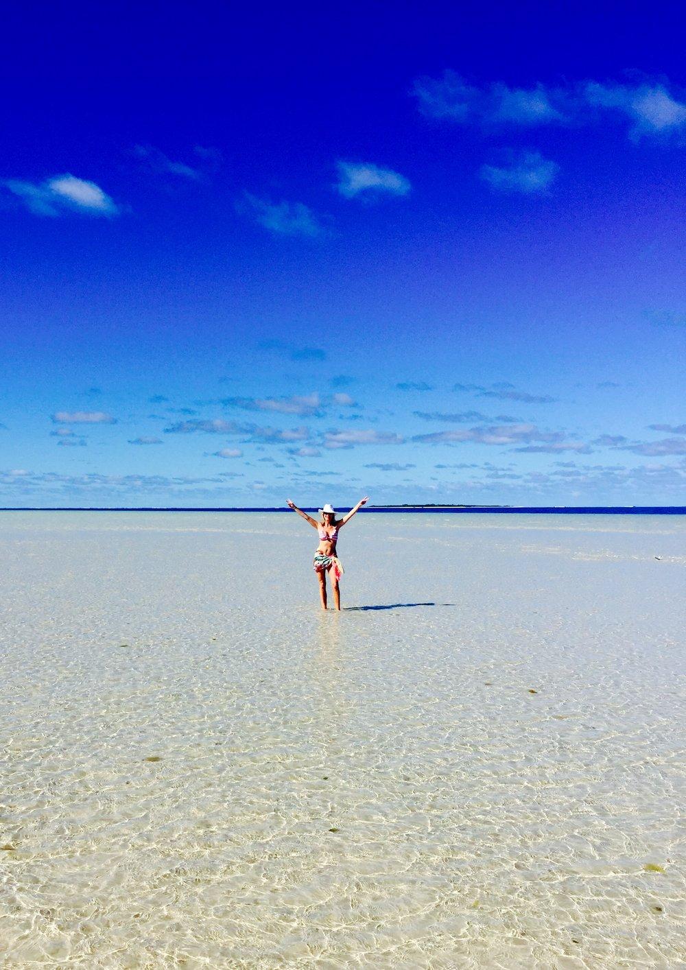 Writer Amanda Platt sun salute, New Caledonia