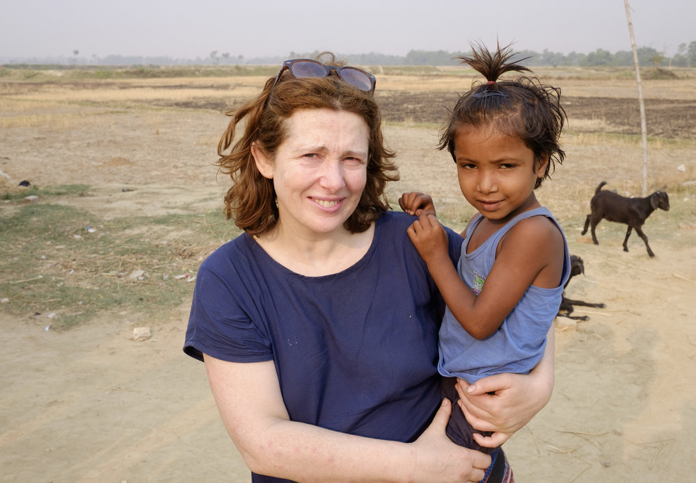 Trish Kerr holding a little girl in the village of Dharmanagar, Nepal. (Photo by Gerry Kerr)