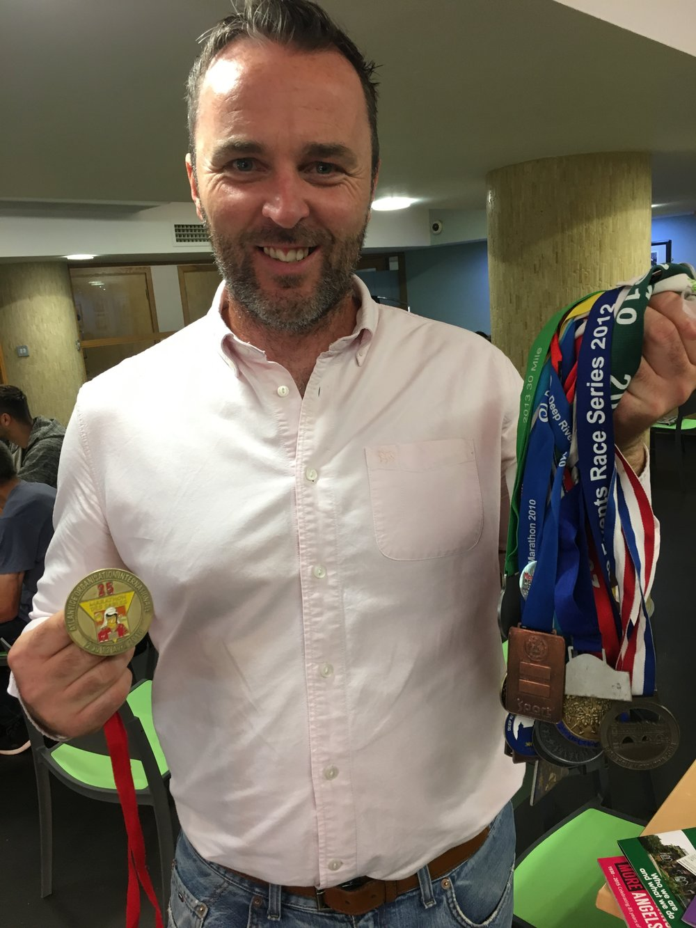 Tom Fitzsimons with his medals.JPG
