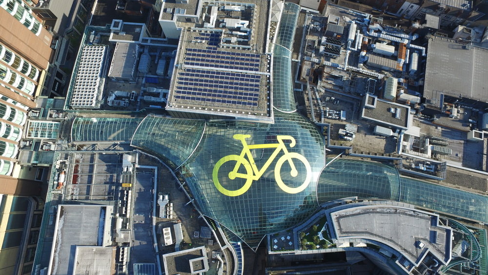 Leeds' largest Tour de Yorkshire yellow bike on the glass dome of Trinity Leeds 1.JPG