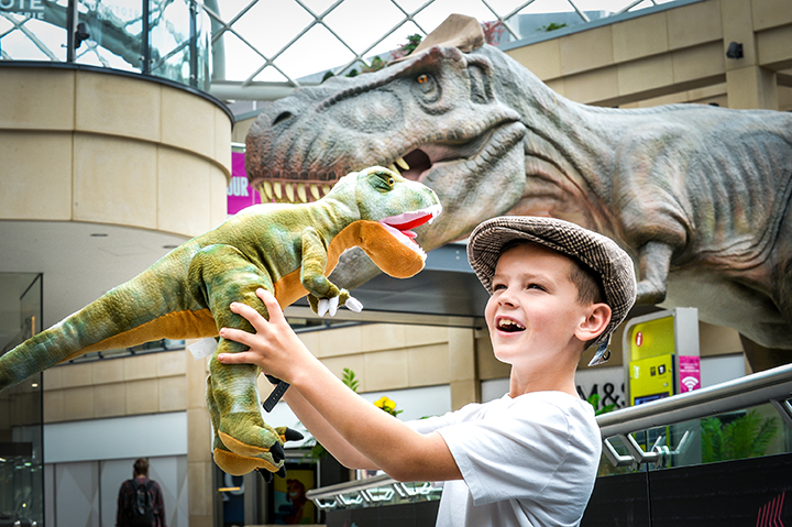 Tommy Appleyard, 8, from Leeds with the Trinity Leeds T-Rex and its flat cap for Yorkshire Day 4.jpg