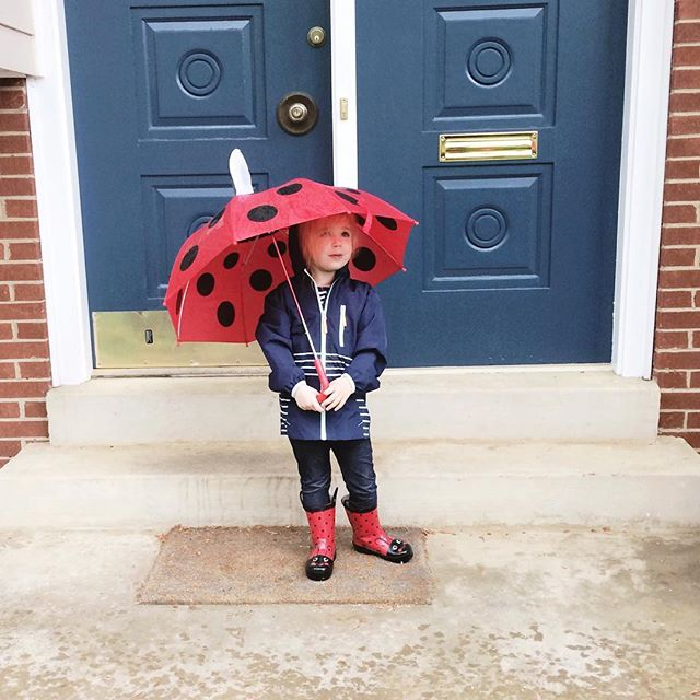 Rainy day fun for kids = splashing in puddles. Rainy day fun for adults = slippers & 🍷.