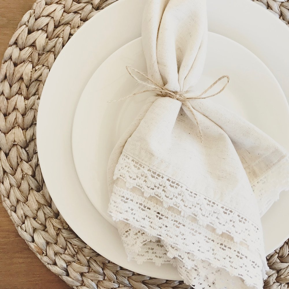 Beautiful Napkins from  Pier1    |   Braided Hyacinth Chargers from  Pier1