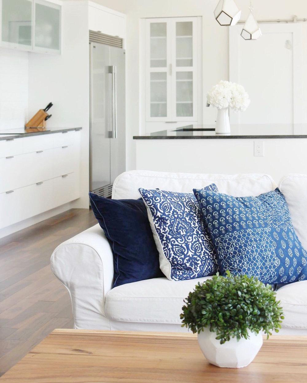 Gorgeous coffee table:  Wicker Emporium  | White sofa:  Ikea  | Pillows: Homesense Canada