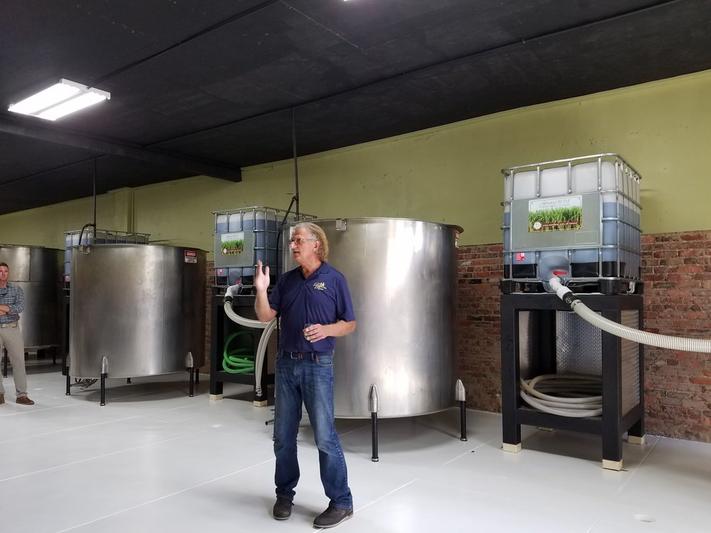 Owner Erik Vonk explains the fermenting process and how the sugar cane is processed into juice.