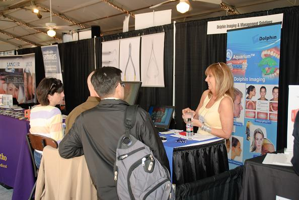 Linda at Dolphin Imaging interacts with some IAO Annual Meeting participants