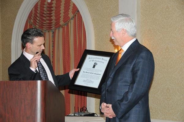 Dr. Brock Rondeau (right) receives a Presidential Citation from IAO President Dr. Brian Billard