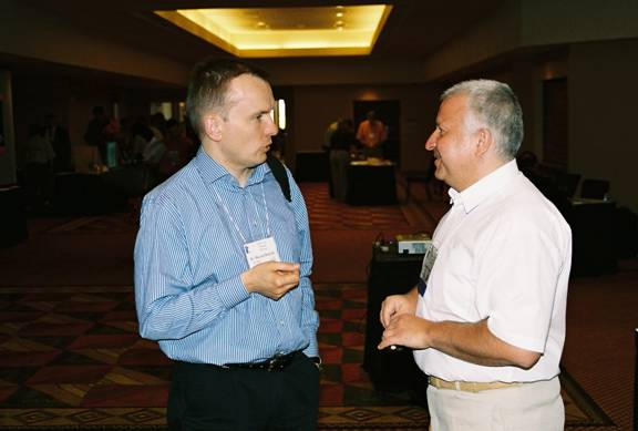 IAO Senior Certified Instructor Dr. Marcin Dolecki converses with IAO Poland section coordinator, Mr. Romulad Ciesielski