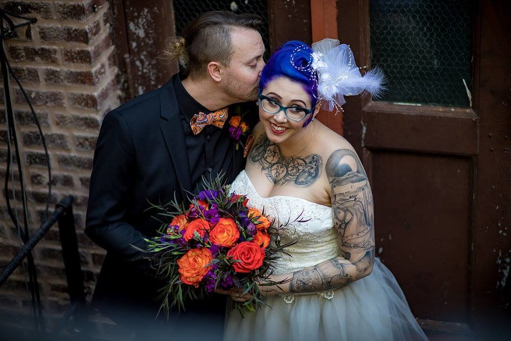 Friday the 13th Goth Victorian Wedding at Stan Mansion in Chicago's Logan Square neighborhood. Off beat bride with purple hair.