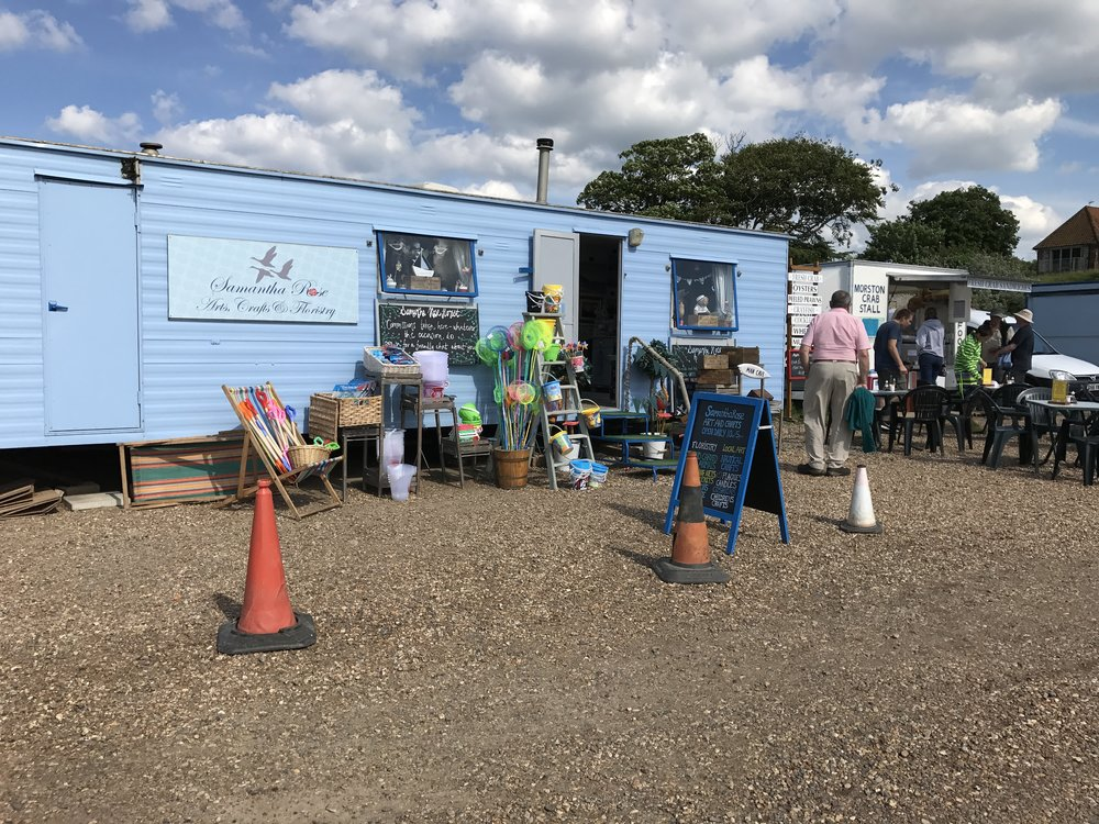 Food on Blakeney Quay - In the warmer months you can usually get all day breakfasts, bacon butties and crab snadwiches on the various food stalls on the National trust car park. Our favcourite is the enormous ''Breakfast Bap'' cooked freshly for you and washed down with a mug of tea. Great if youve been walking the dog or up early crab fishing.