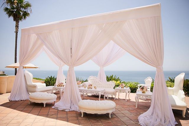 Anybody else feel like taking a nap under this dream canopy?⠀☁️☁️☁️ ⠀ #luxurywedding #cocktailhour #weddingfurniture #whitewedding #wedding #weddingday #weddingideas #instawedding #weddinginspiration #weddinginspo #realweddings #weddinggoals #weddinglove #weddingdetails #theysaidido #newlyweds #bride #brideandgroom #weddingseason #ocwedding #lagunabeach #ritzcarlton #weddingphotos #weddingphotography #weddingplanner #meleamore