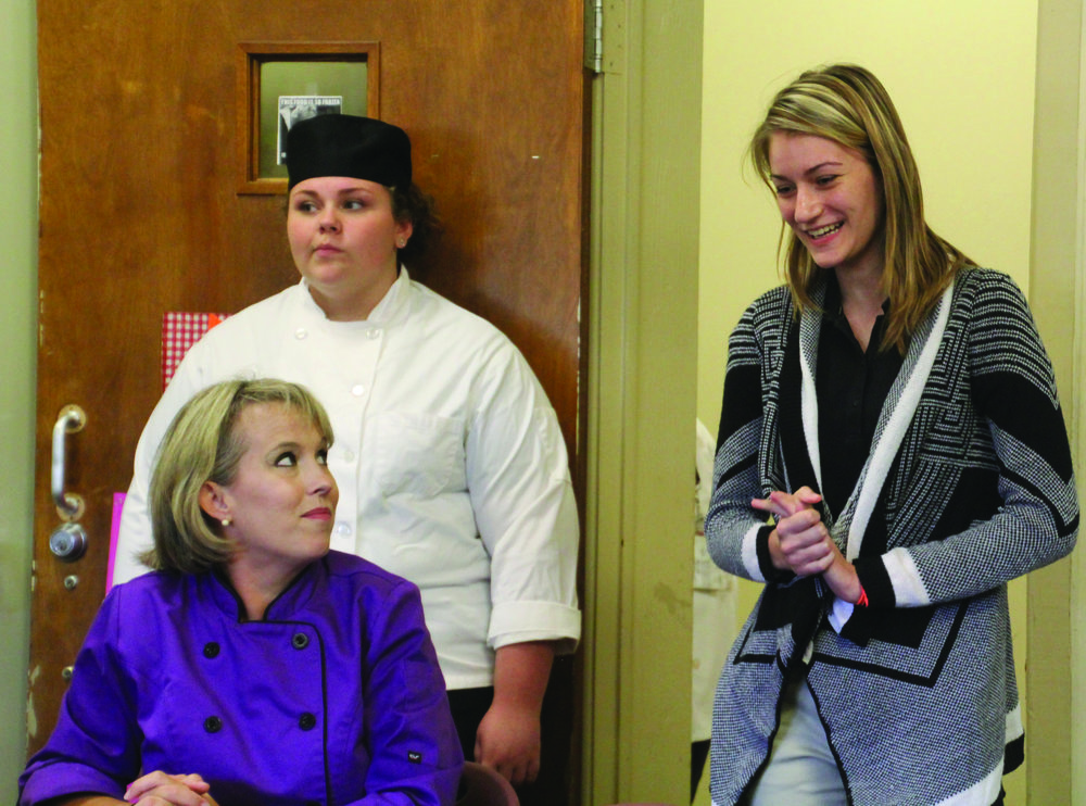 CCCA broadcasting student Emily Pridgen, right, discusses how she and classmate Blair Watts won first place in the nation in a public service announcement contest. Their PSA on bullying, which they wrote and announced, is being broadcast nationwide through the National Association of Broadcasters. Looking on are culinary instructor chef Sherman Axelberg, seated, and Hannah Brown, award-winning commercial baking competitor in state and regional SkillsUSA contests.