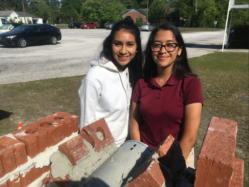 Nancy Ballesteros, left, was learning basic skills in her masonry class this spring as her sister Rossy, right, completed a fi nal Advanced Studies project. Rossy could have graduated in June but decided to stay in school long enough to get her associate degree.