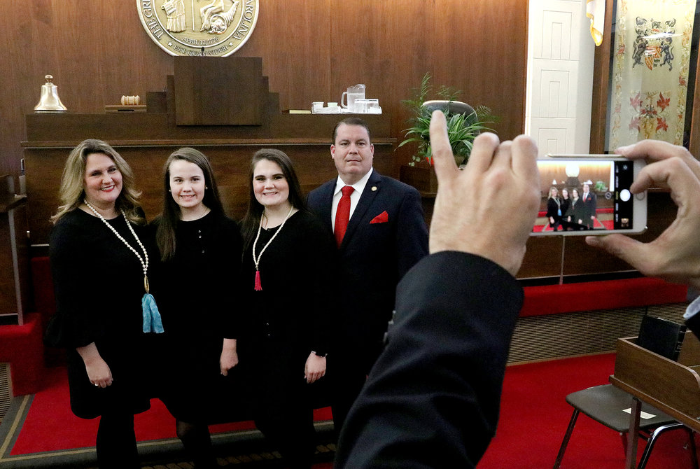 Rep Brenden Jones poses with his family after being sworn into office on January 9, 2019.