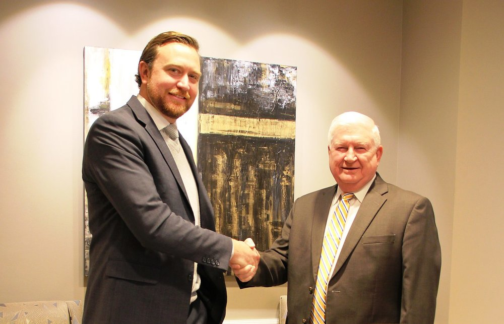Joshua Winslow, left, has been named to succeed retiring Brunswick Electric Membership Corporation CEO Don Hughes, right.