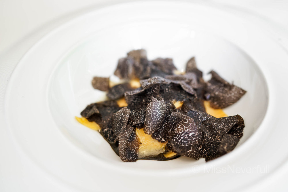 Burrata cheese ravioli with black truffle