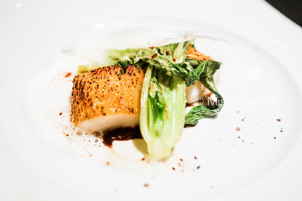 Caramelized Black Cod served with a Malabar pepper sauce and pak-choi flavored with wasabi