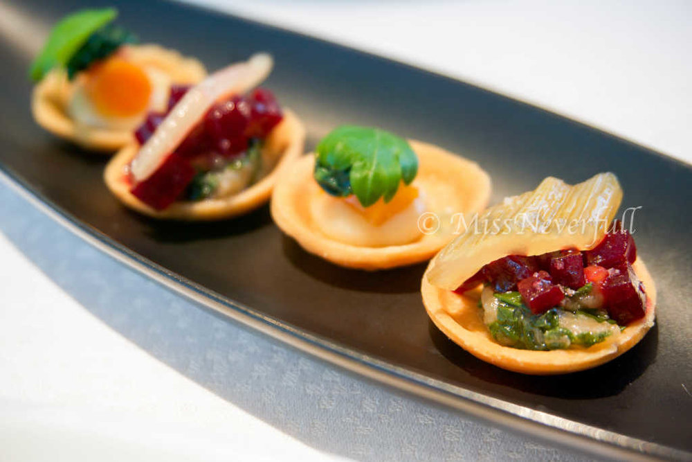 Amuse bouche 1: vegetable tarts, with carrot and beetroot, lemon and passionfruit chocolate.
