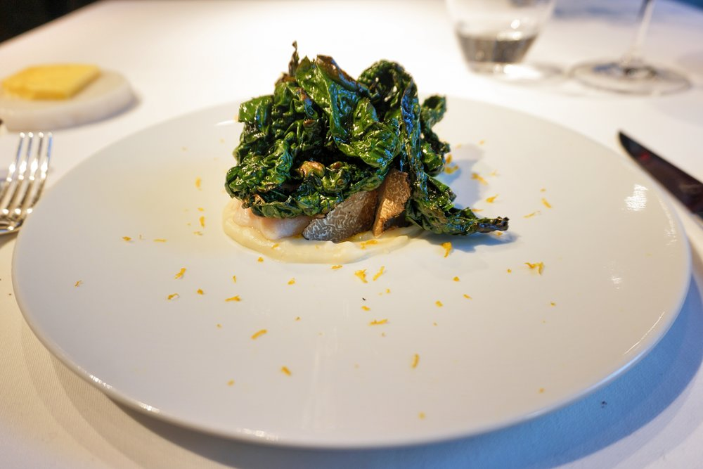 Gently cooked Amadai sea bream , taro puree & a touch of black truffle, cavolo nero, crisp of its scales, lilu bulb, yuzu