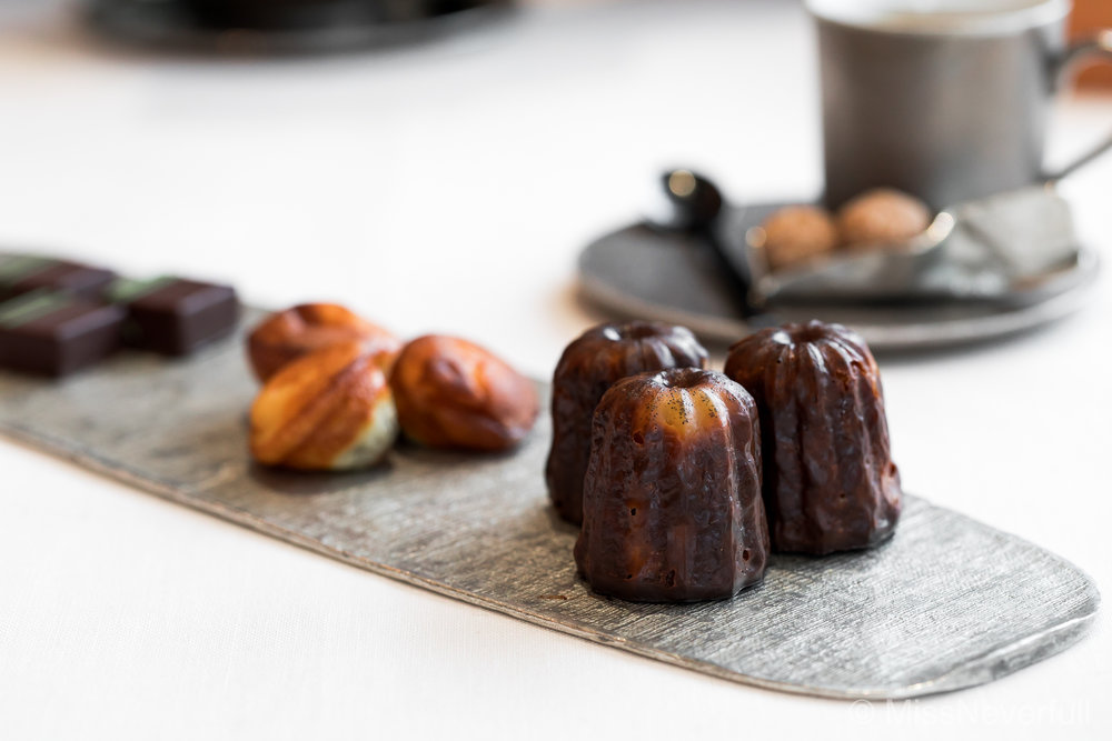 Petit fours: Canele, madelines, and chocolates. Served with your choice of Coffee/Tea.