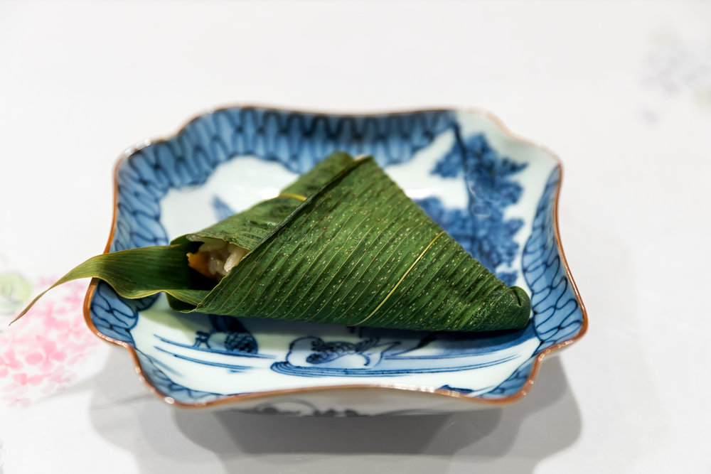 2. Unagi iimushi (eel steamed rice) wrapped in bamboo leaf