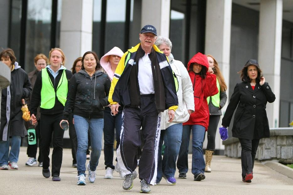 Philip L. Haberstro, executive director of the Wellness Institute of Greater Buffalo, leads a National Walk at Lunch Day event through downtown Buffalo. He'd like to see more people participate in such events in the wake of a new survey that suggests most Western New Yorkers have a long way to go when it comes to hitting fitness benchmarks. (Mark Mulville/Buffalo News file photo)