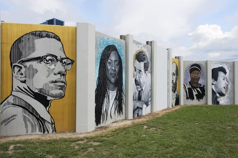 (left to right) Malcolm X, Alicia Garza, George K. Arthur, W. E. B. DuBois, Eva Doyle and Huey P. Newton are among the faces on the Freedom Wall.  ALBRIGHT-KNOX ART GALLERY