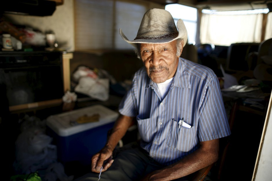 Samuel Cole, 85, of Los Angeles, poses in his motorhome. Cole moved into the vehicle when he wasn't able to afford a $100 rise in his rent. (Lucy Nicholson/Reuters)