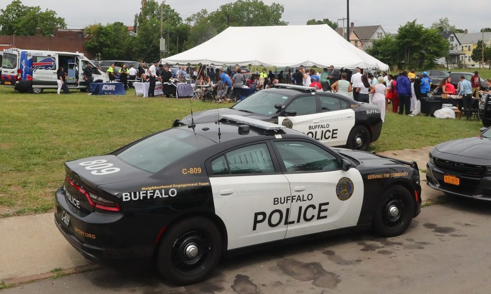 A recent job fair on a vacant lot on Genesee Street and Goodyear Avenue is one outgrowth of renewed efforts to connect police officers with the communities they serve. (John Hickey/Buffalo News)