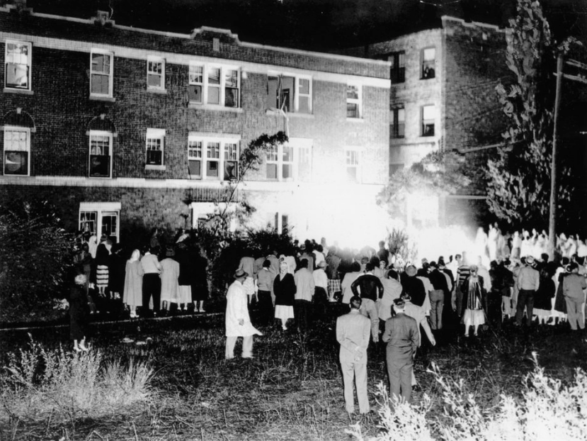 terror  Cicero Crowd (July 12, 1957) Part of a crowd of 3,000 watch a Negro family's furniture burn beside the apartment building at 6139 W. 19th St. Cicero.