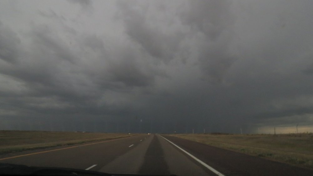The storm as we were driving into it. Lightning struck about every 30 seconds & tornado clouds were gathering all over.