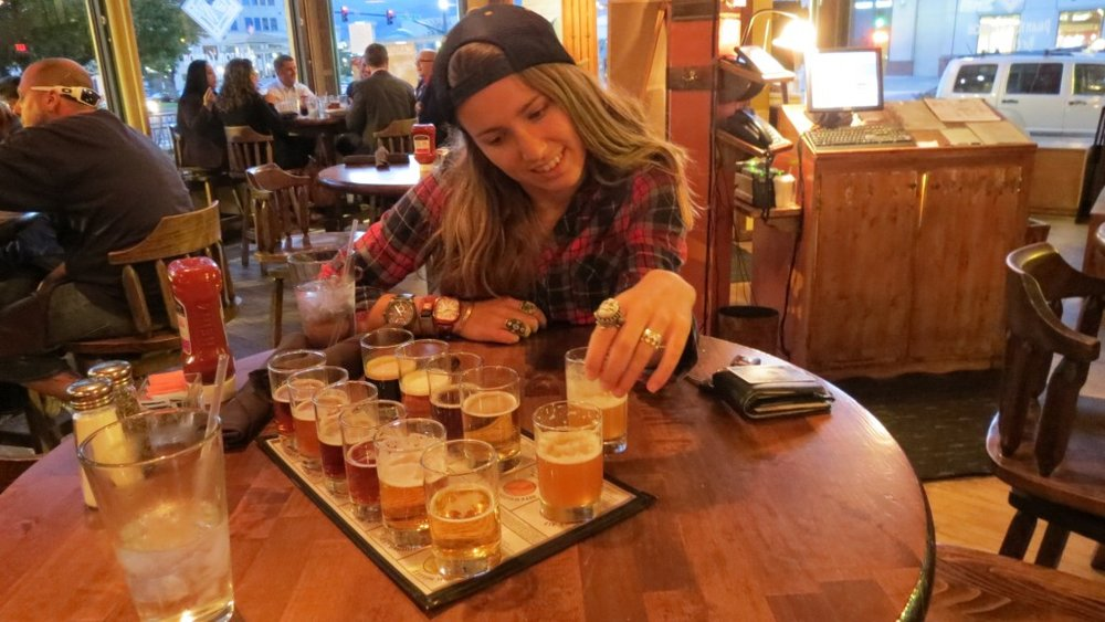 Attempting to be photogenic, examining all the brew pub samples. Boyfriend's favorite was brewed with hot peppers.