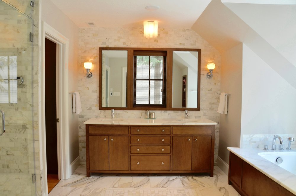 Custom vanity, tub surround, recessed mirrored medicine cabinets and new window.