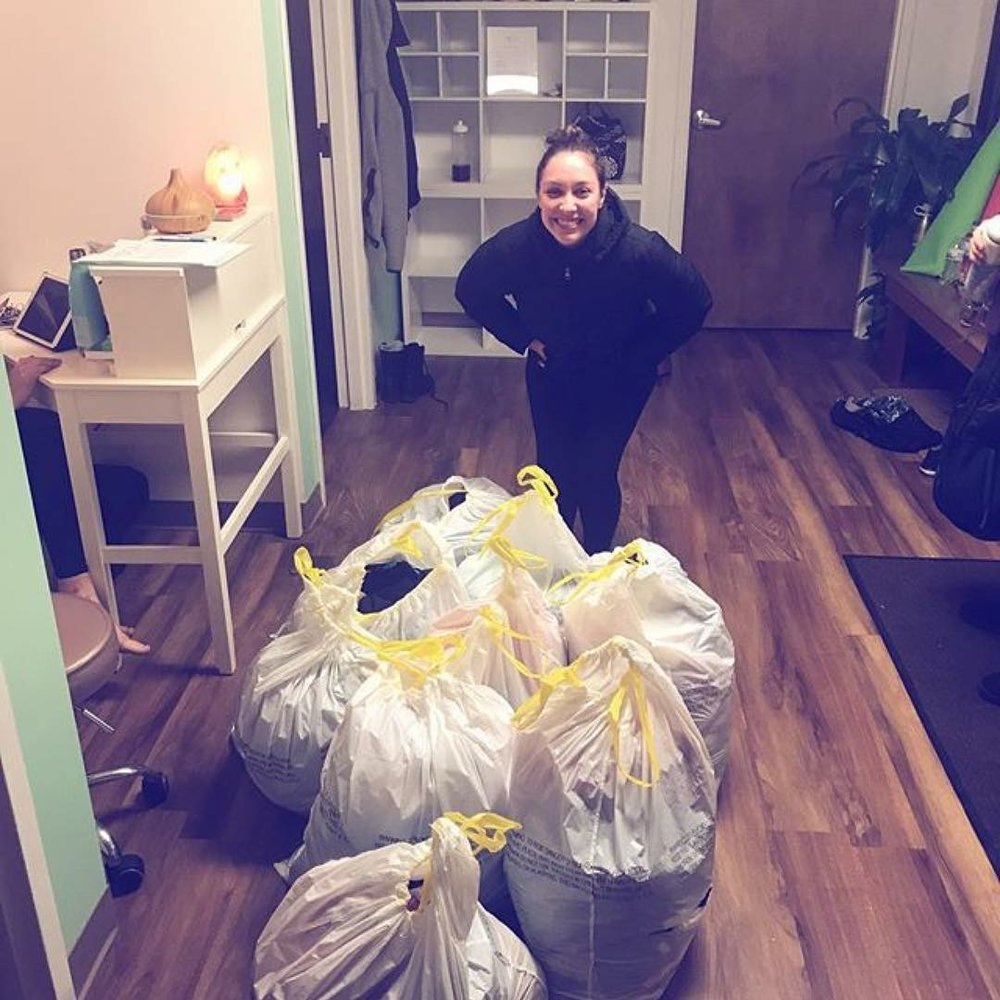Lisa donating NINE bags of clothes to Yoga Squared's Closet Detox for a Cause!