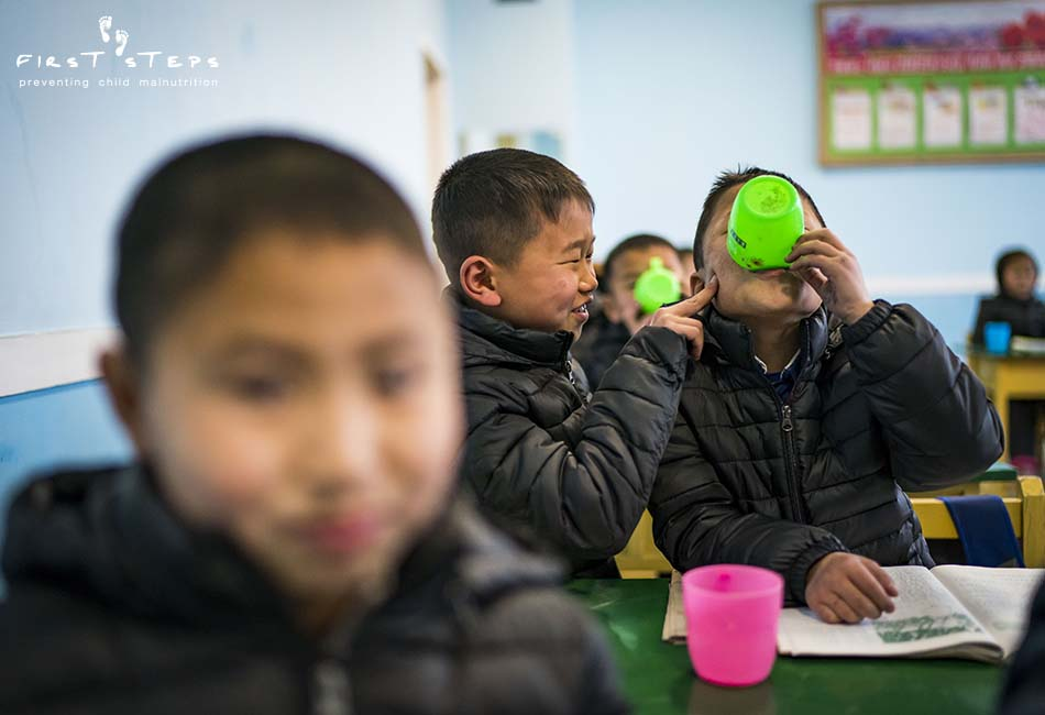 - The students are wearing their jackets in the classroom because the rooms are unheated, another consequence of ongoing sanctions. None of this stops the children from having some fun with each other!