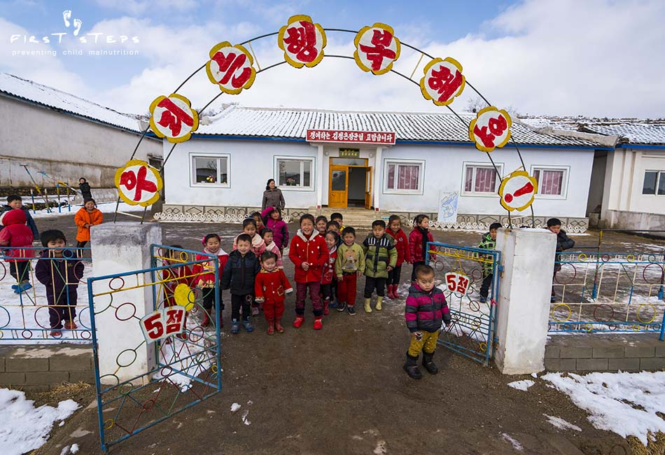 - At the Pungsan Kindergarten in Tongchon the children were curious to see who had come to visit. Only 58% of the children here meet the national standard height for their age. The cup of soymilk is an important part of their daily diet.