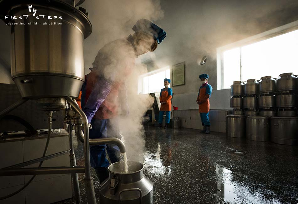 - The Nampo Foodstuff Factory uses energy-efficient First Steps' VitaCows to make the soymilk each day. The VitaCow is powered by electricity and can produce 40 -45 litres of soymilk per hour. In this photo the cooked soymilk pours into a stainless-steel milkcan.