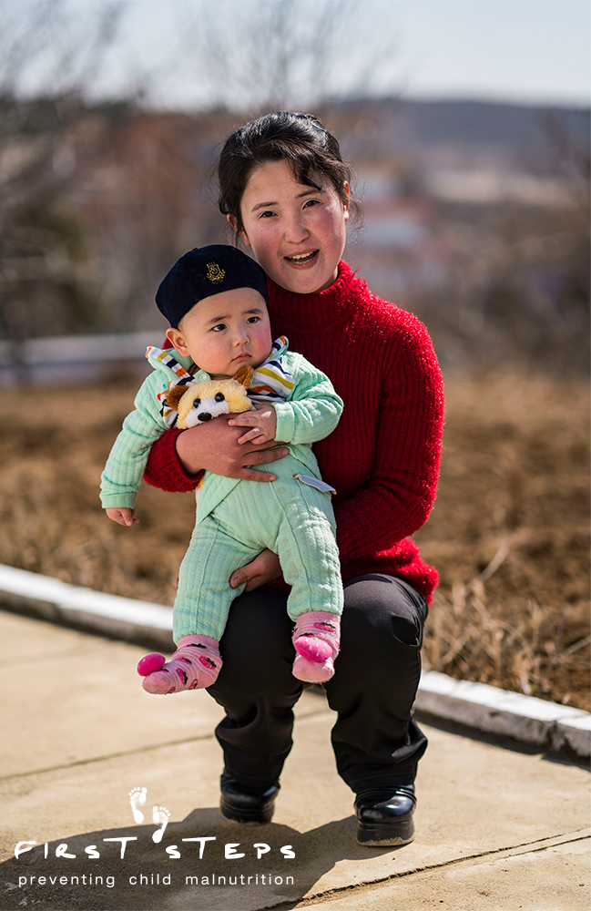 Bak Hyang-Mi and her seven-month old son Kim Won-Ung. Won-Ung will receive Sprinkles until he is two years old.