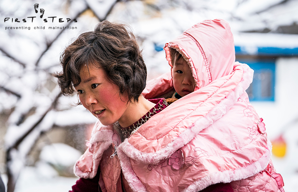 - A mother and her son arriving to the Yangji Daycare in Wonsan, Kangwon Province