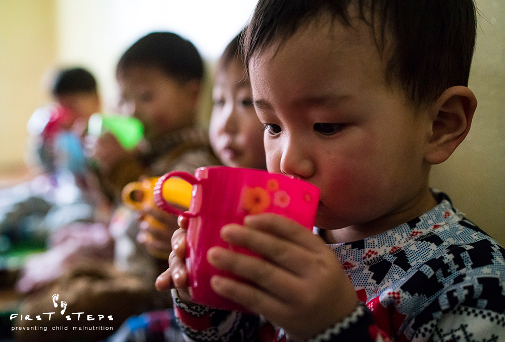 - Careful sips of warm nutritious soymilk at the Yangji Daycare